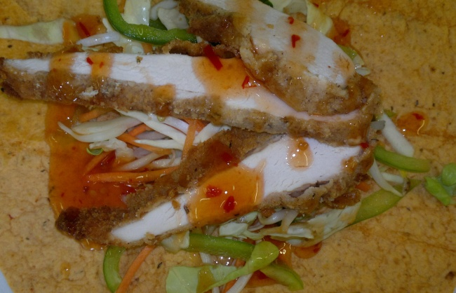Cajun Coated Chicken Strips on Chinese Stir-Fry Salad with Sesame & Chilli Dressing