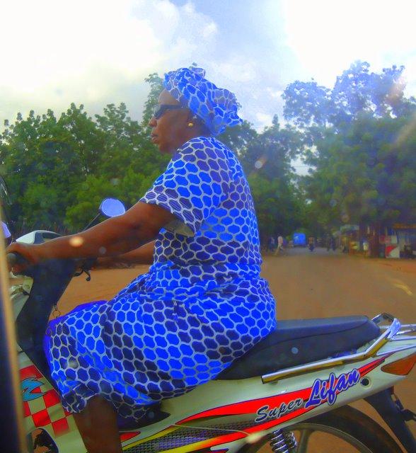 A woman in Bamako, Malu riding an okada