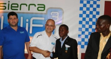 In this photo Kelvin Doe is pictured with the managers of Sierra WIFI
