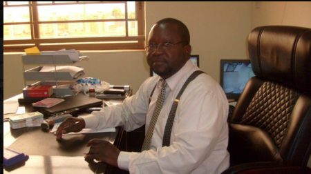 FESTUS CROSBIE - a  Sierra Leone Commercial Bank employee accused of conspiring to defraud the state.
