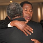 President of Benin, Yayi Boni consoles another president as they await the funeral of President John E Atta Mills