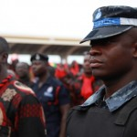 A Ghana policeman stands at attention as the national anthem is played at the funeral of President John Atta Mills