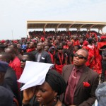 Ghanaian dressed in the mourning colors of red and black at the funeral of President John Atta Mills