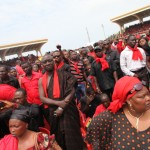 Ghanaians dressed in the mourning colors of red and black at the funeral of President John Atta Mills