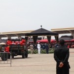 Millitary personnel drive up to transport the remains of President John Atta Mills to the cemetery