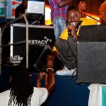 Yaa Pono shakes hand with fellow label mates Fokn Bois during performance at Big in Ghana 2012