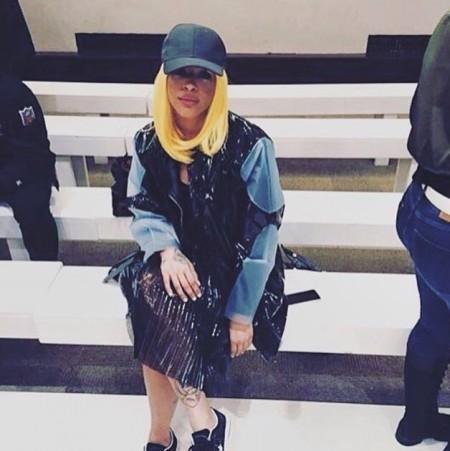 LFW attendee in Sydney Davies heat plated black plastic skirt