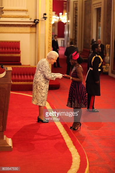 Miss Kumba Musa from Sierra Leone receives a Queen's Young Leaders Award for 2017 from Queen Elizabeth II during a ceremony at Buckingham Palace in London. PRESS ASSOCIATION Photo. Picture date: Thursday June 29, 2017. The Queen's Young Leaders Programme was launched at the time of her Diamond Jubilee and aims to discover, celebrate and support young people across the Commonwealth. See PA story ROYAL Awards. Photo credit should read: Jonathan Brady/PA Wire