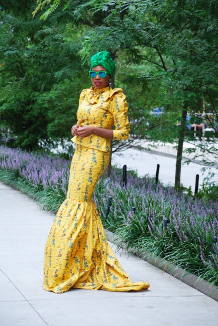 Sai Sankoh brings a modern flavor to the Kaba and slit in this  yellow and green print by J Medz design by Mohamed Jalloh